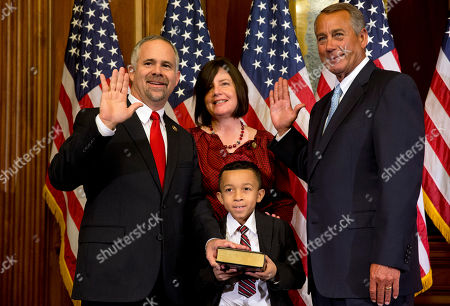 John Boehner, Tim Huelskamp House Speaker John Boehner of Ohio administers a re-enactment of the House oath to Rep. Tim Huelskamp, R-Kansas, with his family, during a ceremonial re-enactment swearing-in ceremony, in the Rayburn Room on Capitol Hill in Washington