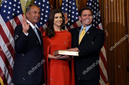 John Boehner, Casey Black DeSantis, Ron DeSantis House Speaker John Boehner of Ohio poses for a photo with Rep. Ron DeSantis, R-Fla., right, and his wife Casey Black DeSantis, center, to re-enact the oath-of-office, on Capitol Hill in Washington