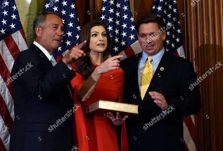 John Boehner, Casey Black DeSantis, Ron DeSantis House Speaker John Boehner of Ohio, left, tells Rep. Ron DeSantis, R-Fla., right, and his wife Casey Black DeSantis, center, which camera to look at as they pose for a photo to re-enact the oath-of-office, on Capitol Hill in Washington