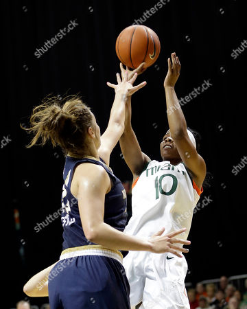 Michelle Woods, Kathryn Westbeld Miami guard Michelle Woods (10) shoots against Notre Dame forward Kathryn Westbeld in the first half of an NCAA basketball game in Coral Gables, Fla