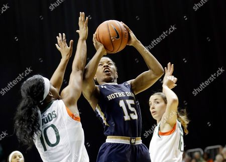 Lindsay Allen, Michelle Woods Notre Dame guard Lindsay Allen (15) prepares to shoot as Miami guard Michelle Woods (10) defends in the second half of an NCAA college basketball game in Coral Gables, Fla., . Miami won 78-63