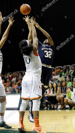 Jewell Loyd, Michelle Woods Notre Dame guard Jewell Loyd (32) shoots over Miami guard Michelle Woods (10) in the second half of an NCAA college basketball game in Coral Gables, Fla., . Miami won 78-63