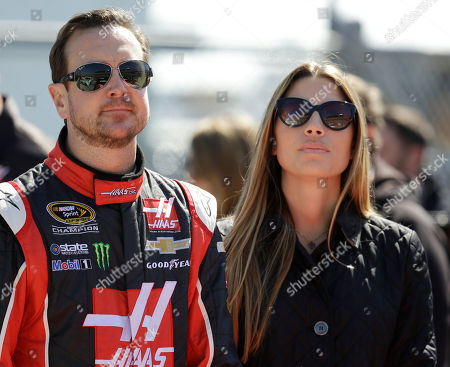 Kurt Busch, Ashley Van Metre Driver Kurt Busch, left, stands with his girlfriend, Ashley Van Metre, before getting in his car during qualifying for the Daytona 500 NASCAR Sprint Cup Series auto race at Daytona International Speedway in Daytona Beach, Fla. NASCAR lifted its suspension of Kurt Busch, and ruled the former champion can compete in the title Chase should he qualify. Busch missed the first three races of the season when NASCAR suspended him for an alleged domestic assault on his ex-girlfriend. The Delaware attorney general last week declined to charge Busch for the September incident with Patricia Driscoll
