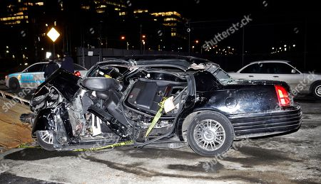 """A car remains on the scene of an accident in New York, that killed longtime """"60 Minutes"""" correspondent Bob Simon. Simon covered riots, Academy Award-nominated movies and wars and was held captive for more than a month in Iraq two decades ago. He was 73"""
