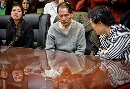 Ramos, Liu Pei Xia Chen, left, the wife of slain NYPD officer Wenjian Liu, his father Wei Tang Liu, center, and his mother Xiu Yan Liu, right, listen during a press conference at the Detectives Endowment Association, announcing an anonymous $1 million donation to benefit the family, in New York. Robin Mui, CEO of New York's Sing Tao newspapers facilitated the donation from the anonymous benefactor in Hong Kong, who requested that Liu's family and the family of his slain partner Rafael Ramos, each receive $500,000