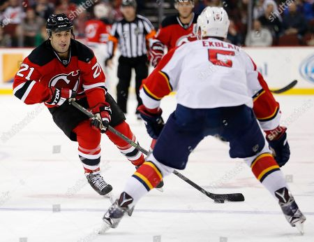 Scott Gomez, Aaron Ekblad New Jersey Devils center Scott Gomez, left, skates against Florida Panthers defenseman Aaron Ekblad during the second period of an NHL hockey game, in Newark, N.J