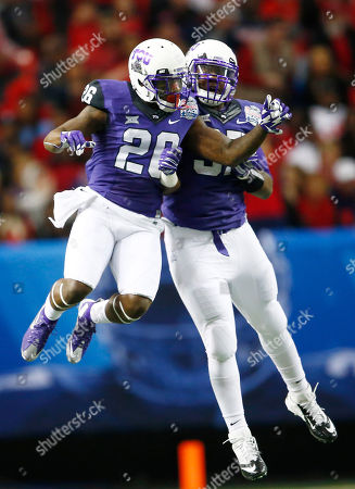 TCU safety Derrick Kindred (26) celebrates his interception with TCU defensive tackle Chris Bradley (97) against Mississippi during the first half of the Peach Bowl NCAA football game, in Atlanta