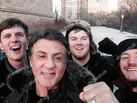 Sylvester Stallone Provided by Peter Rowe, Rowe, right, takes a selfie with friends Jacob Kerstan, left, Andrew Wright, third from left and actor Sylvester Stallone in Philadelphia. Rowe said the three friends had just finished racing up the staircase at the city's Museum of Art when they saw Stallone. Stallone made the steps famous in his first turn as fictional boxer Rocky Balboa, who used them as part of his training regimen. Thousands of people now visit the steps each year to re-create the run