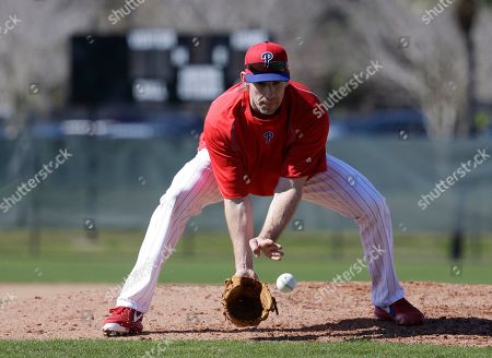 Cliff Lee Philadelphia Phillies starting pitcher Cliff Lee fields a ball during a spring training baseball workout, in Clearwater, Fla