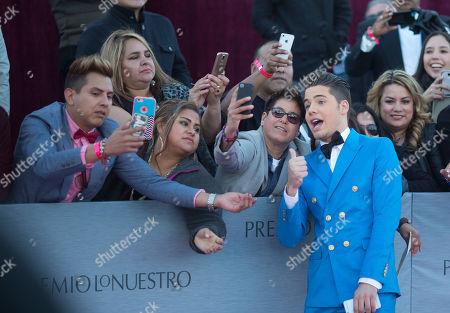 William Valdes William Valdes poses for photos with fans before the Premio Lo Nuestro awards show in Miami