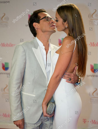 Shannon De Lima, Marc Anthony Marc Anthony kisses his wife Shannon De Lima as they arrive at the Premio Lo Nuestro Latin Music Awards show, in Miami, Fla
