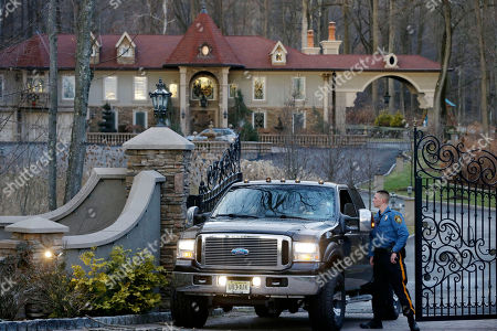 "A police officer talks with the driver of a truck carrying children from the home of Teresa Giudice, a cast member of Bravo's ""Real Housewives of New Jersey,"" and her husband Giuseppe ""Joe"" Giudice, in the Towaco section of Montville Township, N.J. Teresa Giudice is scheduled to report to a federal prison in Danbury, Connecticut, on Monday morning to begin serving a 15-month sentence for bankruptcy fraud. U.S. District Judge Esther Salas staggered her sentence with her husband's so they wouldn't be in prison at the same time and unable to care for their four daughters. She and her husband pleaded guilty last year and admitted hiding assets from bankruptcy creditors and submitting phony loan applications to get some $5 million in mortgages and construction loans"
