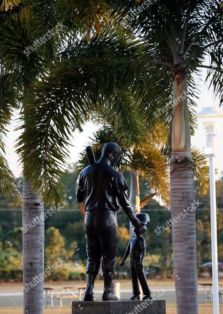 A statue of Boston Red Sox legend Ted Williams placing a ball cap on the head of a child sits in front of jetBlue Park, the team's baseball spring training facility in Fort Myers, Fla., . Red Sox pitchers and catchers are scheduled to begin workouts Saturday
