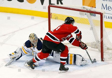 Scott Gomez, Michal Neuvirth New Jersey Devils center Scott Gomez, right, scores against Buffalo Sabres goalie Michal Neuvirth, of the Czech Republic, during a shootout in an NHL hockey game, in Newark, N.J. The Devils won 2-1