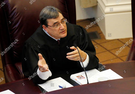 Stock Picture of Randy Pierce Mississippi Supreme Court Judge Randy Pierce questions an attorney during oral arguments over whether the state should grant a same sex divorce without declaring that state constitution or law violates the U.S. Constitution, in Jackson, Miss. The full court listened to arguments that Mississippi should find a way to grant a divorce to a DeSoto County woman who married another woman in California in 2008. The state argued that it can't grant a divorce to Lauren Czekala-Chatham and Dana Ann Melancon because their same sex marriage is void in Mississippi