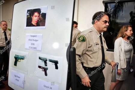 Bill Brown Santa Barbara County Sheriff Bill Brown, right, walks past a board showing the photos of gunman Elliot Rodger and the weapons he used in the mass shooting that took place in Isla Vista, Calif., after a news conference in Santa Barbara, Calif. Authorities concluded that Rodger, who killed six people and injured 13 others near the University of California, Santa Barbara, last year acted alone. The Sheriff's Office released a report, on its eight-month investigation into the massacre