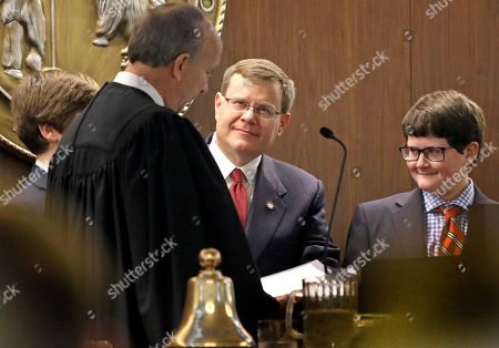 Tim Moore, Paul Newby, Wilson Newby North Carolina Rep. Tim Moore, R-Cleveland, center, is sworn as the new Speaker of the House by Justice Paul Newby, left, as Moore's son Wilson watches during the opening session of the North Carolina Legislature, in Raleigh, N.C