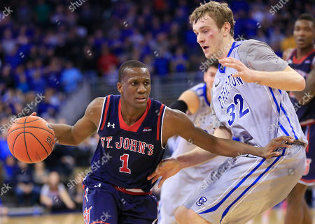 Toby Hegner, Phil Greene IV St. John's Phil Greene IV (1) tries to drive past Creighton's Toby Hegner (32) during the second half of an NCAA college basketball game in Omaha, Neb., . Creighton won 77-74