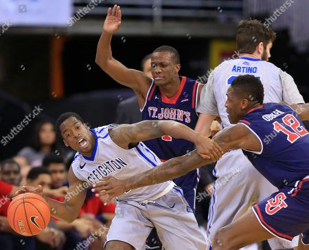 Chris Obekpa, Austin Chatman, Phil Greene IV Creighton's Austin Chatman, left, is guarded by St. John's Chris Obekpa (12) and St. John's Phil Greene IV, rear, during the first half of an NCAA college basketball game in Omaha, Neb