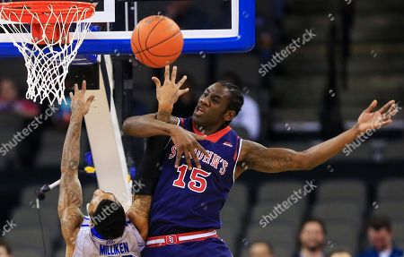 James Milliken, Sir'Dominic Pointer St. John's Sir'Dominic Pointer (15) swats the ball away from Creighton's James Milliken (23) during the first half of an NCAA college basketball game in Omaha, Neb