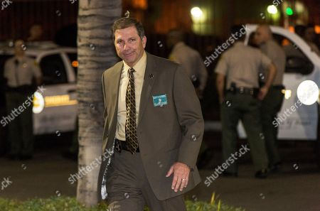 "Los Angeles County Sheriff's Department Lt. John Corina arrives at a news brief at the scene of an accident in a parking lot in Compton, Calif., . A lawyer for Marion ""Suge"" Knight, a Death Row Records founder, says Knight was driving a car involved in an accident"