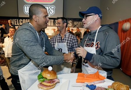 Victor Martinez Detroit Tigers' Victor Martinez, left, shakes hands with Brian Zilo, next to manager Brad Ausmus, center, after they competed in a sandwich making contest during an employee rally at the Lipari Foods plant in Warren, Mich., . Martinez and teammates were taking part in the 2015 Detroit Tigers Winter Caravan which will be making more than 30 stops throughout the region