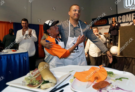 Victor Martinez Detroit Tigers' Victor Martinez is hugged by Diane Muravchick after they won the sandwich making contest during an employee rally at the Lipari Foods plant in Warren, Mich., . Martinez and teammates were taking part in the 2015 Detroit Tigers Winter Caravan which will be making more than 30 stops throughout the region