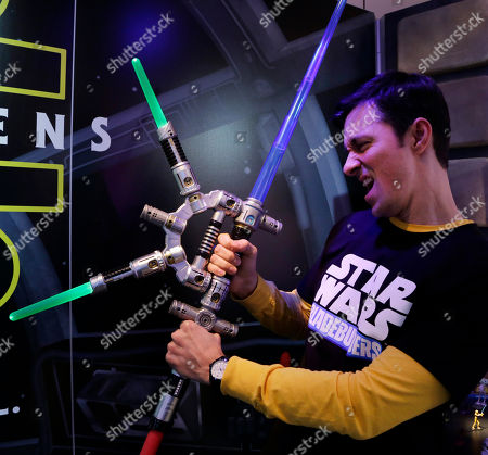 Stock Picture of Jeff Wolf Jeff Wolf demonstrates the Star Wars Bladebuilders Jedi Master Lightsaber at the Hasbro showroom at the North American International Toy Fair, in New York