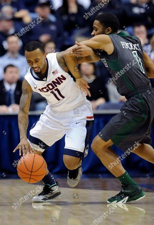 Ryan Boatright, Keith Pinckney Connecticut's Ryan Boatright (11) is fouled by Tulane's Keith Pinckney (1) during the first half of an NCAA college basketball game, in Storrs, Conn