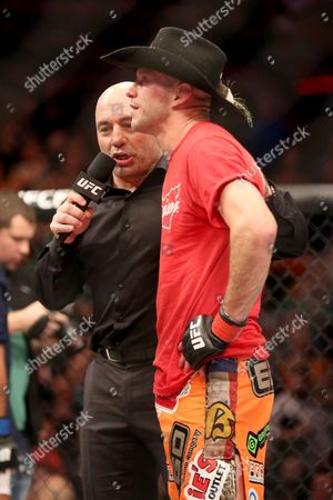 Donald Cerrone, Joe Rogan Donald 'Cowboy' Cerrone is seen with announcer Joe Rogan after his fight against Benson Henderson during their lightweight fight at UFC Fight Night Boston, in Boston. Cerrone won via unanimous decision