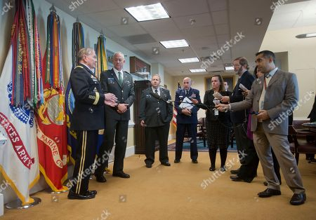 Martin E. Dempsey, Benny Gantz Joint Chiefs Chairman Gen. Martin E. Dempsey, left, and the Israeli Defense Minister Benny Gantz, right, talk with each other before answering questions from members of the media at the Pentagon