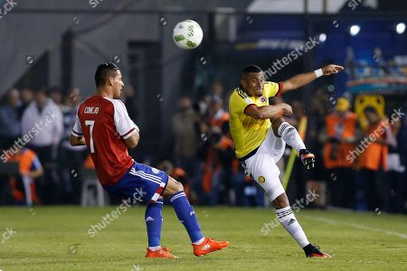 Jorge Benitez, Farid Diaz Colombia's Farid Diaz, right, kicks the ball past Paraguay's Jorge Benitez during a 2018 World Cup qualifying match in Asuncion, Paraguay
