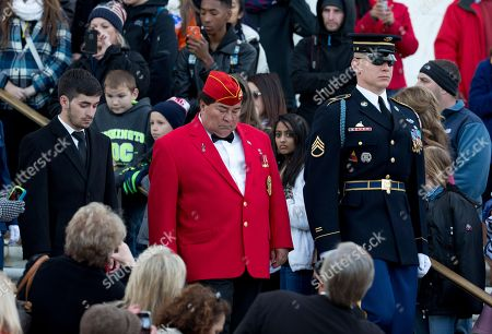 Jose Ramon Rodriguez, Jojo Rodriguez, Christopher Carney Jose Ramon Rodriguez, center, nephew of Medal of Honor Soldier, Army Pvt. Miguel A. Vera, from the Korean War, and his son Jojo Rodriguez, left, is escorted by Army Staff Sgt. Christopher Carney, right, during a wreath laying ceremony at the Tomb of the Unknowns at Arlington National Cemetery in Arlington, Va., . Earlier, Pvt. Vera's remains were buried at the cemetery