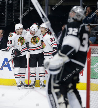 Jonathan Quick, Brad Richards, Patrick Kane, Kris Versteeg Chicago Blackhawks' Patrick Kane(88), Brad Richards(91) and Kris Versteeg(23) celebrate a goal by Richards as Los Angeles Kings goalie Jonathan Quick, foreground, stands on the ice during the first period of an NHL hockey game, in Los Angeles