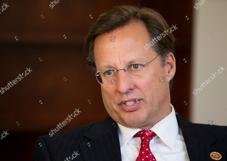 """Stock Image of Dave Brat Nov. 18, 2014, freshman Rep. Dave Brat, R-Va., the economics professor who toppled former House Majority Leader Eric Cantor in the June GOP primary, in interviewed by The Associated press in his office on Capitol Hill in Washington, . Five months after his upset of Cantor, Brat comes across as down-to-earth and says his constituents have warned him not to let Washington change him. """"Everyone just says, 'Dave, keep being yourself,'"""" Brat said in an interview in his sparsely decorated office this week. """"'You better not change. You better keep being Dave"""