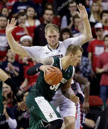 Przemek Karnowski, Brian Bennett Gonzaga's Przemek Karnowski holds up his arms as he defends Cal Poly's Brian Bennett during the second half of an NCAA college basketball game, in Seattle. Gonzaga won 63-50