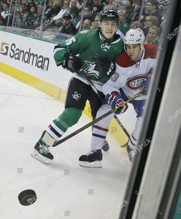 Mike Weaver, Ryan Garbutt Montreal Canadiens defenseman Mike Weaver (43) and Dallas Stars left wing Ryan Garbutt (16) crash the board as they chase the puck during the first period of an NHL hockey game, in Dallas