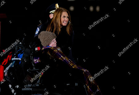 Michele Bachmann, Aaron Urban Rep. Michele Bachmann, R-Minn., talks to Make-A-Wish Foundation recipient Aaron Urban, 10, from Linthicum, Md., after lighting the U.S. Capitol Christmas Tree at the West Front of the Capitol in Washington, . The 2014 U.S. Capitol Christmas Tree is an 88-foot white spruce from the Chippewea National Forest in Cass Lake, Minn