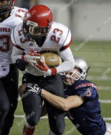 Liberty Christian's John Lesser, right, tackles Neah Bay's Christopher Martinez in the first half of the Washington state Class 1B high school football championship game, in Tacoma, Wash