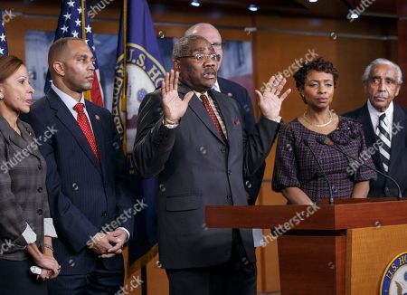 """Nydia M. Velazquez, Hakeem Jeffries, Gregory W. Meeks, Joe Crowley, Yvette D. Clarke, Charlie Rangel Rep. Gregory W. Meeks, D-N.Y., refers to the """"hands up, don't shoot"""" protest cry as he and members of the House of Representatives New York delegation meet with reporters at the Capitol about the grand jury's decision in the Eric Garner case in Washington, . A grand jury cleared the white New York City police officer Wednesday in the videotaped chokehold death of Garner, an unarmed black man, who had been stopped on suspicion of selling loose, untaxed cigarettes, a lawyer for the victim's family said. A video shot by an onlooker and widely viewed on the Internet showed the 43-year-old Garner telling a group of police officers to leave him alone as they tried to arrest him. The city medical examiner ruled Garner's death a homicide and found that a chokehold contributed to it. From left to right are, Rep. Nydia M. Velazquez, D-N.Y., Rep. Hakeem Jeffries, D-N.Y., Rep. Gregory W. Meeks, D-N.Y., Rep. Joe Crowley, D-N.Y., rear, Rep. Yvette D. Clarke, D-N.Y., and Rep. Charlie Rangel, D-N.Y"""