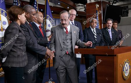 Nydia M. Velazquez, Gregory W. Meeks, Hakeem Jeffries, Eliot L. Engel, Joe Crowley, Charlie Rangel, José E. Serrano, Yvette D. Clarke Members of the New York delegation of the House of Representatives show support for one another as they speak to reporters about the grand jury's decision in the Eric Garner case at the Capitol in Washington, . A grand jury cleared the white New York City police officer Wednesday in the videotaped chokehold death of Garner, an unarmed black man, who had been stopped on suspicion of selling loose, untaxed cigarettes, a lawyer for the victim's family said. A video shot by an onlooker and widely viewed on the Internet showed the 43-year-old Garner telling a group of police officers to leave him alone as they tried to arrest him. The city medical examiner ruled Garner's death a homicide and found that a chokehold contributed to it. From left are Rep. Nydia M. Velazquez, D-N.Y., Rep. Gregory W. Meeks, D-N.Y., Rep. Hakeem Jeffries, D-N.Y., Rep. Eliot L. Engel, D-N.Y., Rep. Joe Crowley, D-N.Y., Rep. Charlie Rangel, D-N.Y., Rep. José E. Serrano, D-N.Y., and Rep. Yvette D. Clarke, D-N.Y