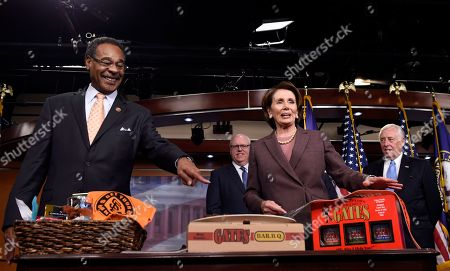 Nancy Pelosi, Emanuel Cleaver, Joseph Crowley, Steny Hoyer House Minority Leader Nancy Pelosi of Calif. accepts a BBQ Platter from Kansas City's Gates BBQ from Rep. Emanuel Cleaver II, D-Mo., as they paid off a World Series bet on Capitol Hill in Washington, . The San Francisco Giants defeated the Kansas City Royals in the World Series. From left are, Cleaver, Rep. Joseph Crowley, D-N.Y., Pelosi and House Minority Whip Steny Hoyer of Md