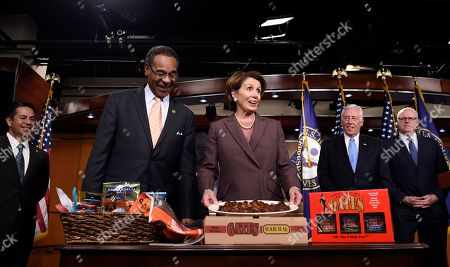 Stock Picture of Nancy Pelosi, Emanuel Cleaver House Minority Leader Nancy Pelosi of Calif. accepts a BBQ Platter from Kansas City's Gates BBQ from Rep. Emanuel Cleaver II, D-Mo., as they paid off a World Series bet on Capitol Hill in Washington