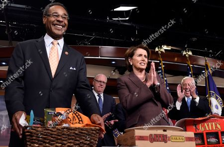 Stock Image of Nancy Pelosi, Emanuel Cleaver, Joseph Crowley, Steny Hoyer House Minority Leader Nancy Pelosi of Calif., accepts a BBQ Platter from Kansas City's Gates BBQ from Rep. Emanuel Cleaver II, D-Mo., left, as Cleaver paid off a World Series bet on Capitol Hill in Washington, . The San Francisco Giants World Series defeated the Kansas City Royals in the recent World Series. From left are, Cleaver, Rep. Joseph Crowley, D-N.Y., Pelosi and House Minority Whip Steny Hoyer of Md