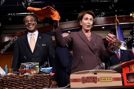 Nancy Pelosi, Emanuel Cleaver House Minority Leader Nancy Pelosi of Calif., twirls a San Francisco Giants baseball rally towel as Rep. Emanuel Cleaver II, D-Mo., watches after they pay off a World Series bet on Capitol Hill in Washington, . With the Giants World Series win over the Kansas City Royals Clever present Pelosi with a BBQ Platter from Kansas City's Gates BBQ
