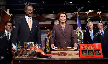 Nancy Pelosi, Emanuel Cleaver House Minority Leader Nancy Pelosi of Calif. accepts a BBQ Platter from Kansas City's Gates BBQ from Rep. Emanuel Cleaver II, D-Mo., as they paid off a World Series bet on Capitol Hill in Washington