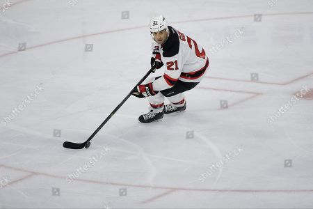 New Jersey Devils' Scott Gomez in action during an NHL hockey game against the Philadelphia Flyers, in Philadelphia