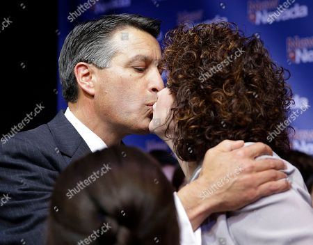 Brian Sandoval, Kathleen Sandoval Nevada Gov. Brian Sandoval kisses his wife Kathleen Sandoval during a victory speech, in Las Vegas. Sandoval defeated Bob Goodman for governor of Nevada