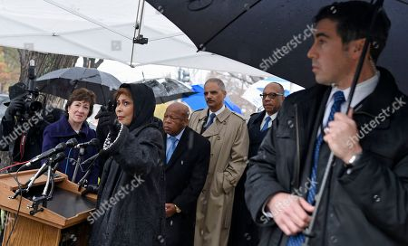 """Eugene Robinson, Janet Langhart Cohen, John Lewis, Eric Holder, Susan Collins Janet Langhart Cohen, second from left, author of the play """"Anne and Emmett,"""" speaks during a tree planting in honor of Emmett Till, a young African-American killed in 1955, during a ceremony on Capitol Hill in Washington, . From left are, Sen. Susan Collins, R-Maine, Langhart Cohen, Rep. John Lewis, D-Ga., Attorney General Eric Holder, and Eugene Robinson of the Washington Post"""