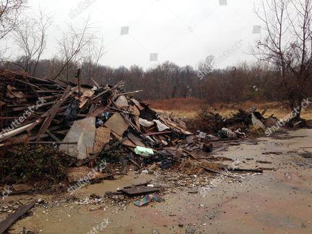 This photo shows a pile of construction debris sitting on the site of a proposed urban farm and hydroponic greenhouse on Washington parkland on the city's southeastern tip. Mayor Vincent Gray announced a deal with BrightFarms Inc. to build the greenhouse last year, but the company is considering abandoning the project because of extensive contamination on the city-owned site, which has been used for years for illegal dumping and an unlicensed landfill